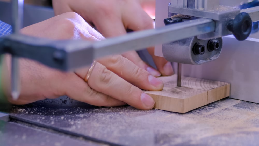 A close-up view of a piece of wood being cut
