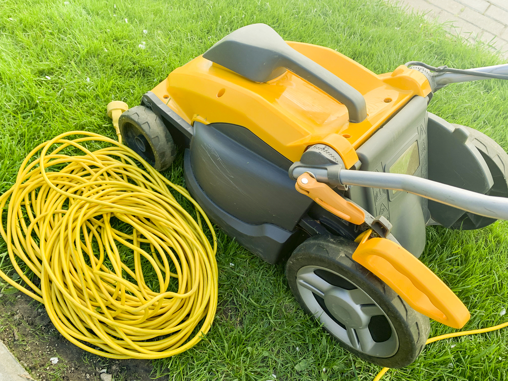 A mowing machine and a yellow cable