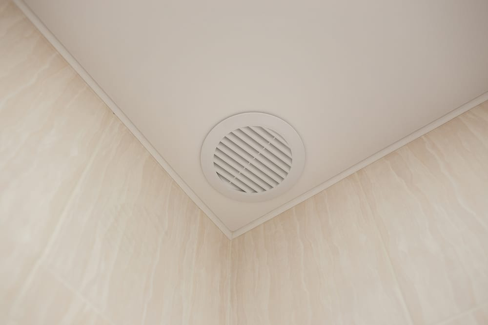 An electric exhaust system installed in a bathroom's ceiling.