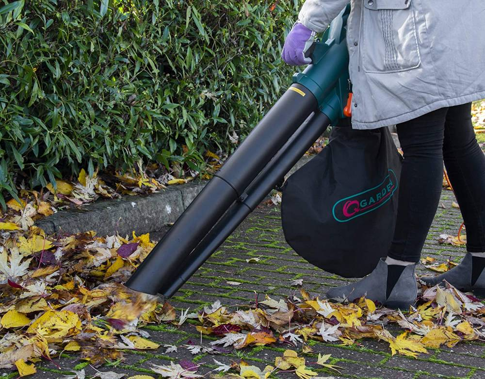 clearing up fallen leaves on a pavement