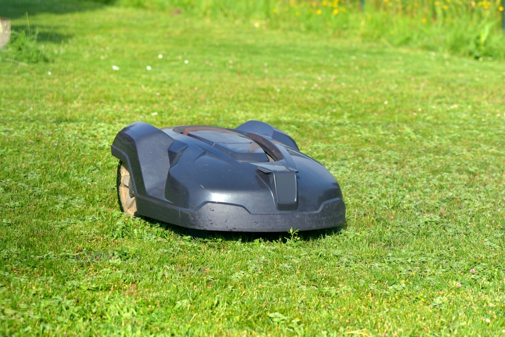 how does a robotic lawn mower work